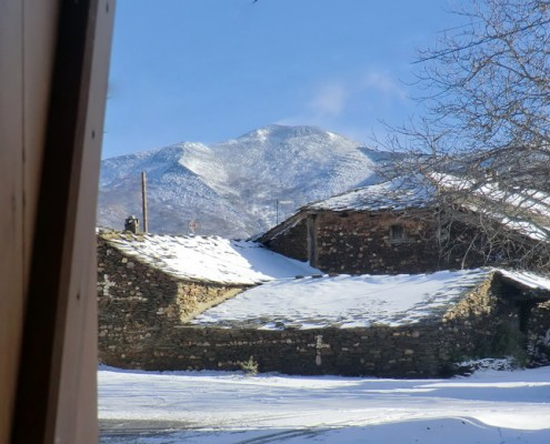 Casas de El Espinar y Ocejón nevado