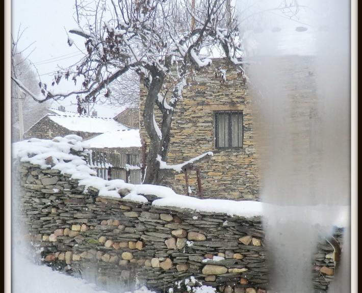 nieve tras el cristal